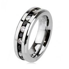 Stainless Steel Eternity Ring with CZ    Material: stainless steel   Gemstones: black and white 3mm cubic zirconia   Width: 1/4-inch at widest point   Comfort fit   The photo shows front and back view of ring. One side has all black Cubic Zirconia and the other has alternating black and clear Cubic Zirconia