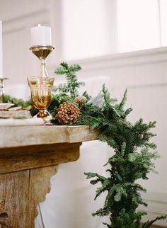 Pine Bough Runner with White Candles and Amber Glassware | Jacque Lynn Photography and Michelle Leo Events | Enchanting Woodland Wedding Shoot with Rustic Winter Details