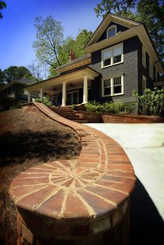 NeelyDesign Portfolio - Renovations and Restorations.....brick retaining wall for for the driveway
