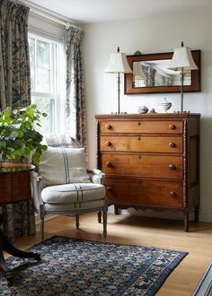 French Colonial Traditional Vintage Bedroom: A blue area rug beside a wooden dresser topped with matching table lamps . Dresser, Lowboy, Chest Of Drawers, Dresser Top, Credenza, Dressers, Tack Box, Closets