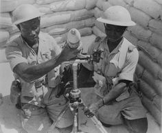 Posed photo of French colonial troops firing a mortar in the Western Desert, A real history of these troops (and their opposites serving with the British Army) has never been adequately addressed. African English, Afrika Corps, North African Campaign, Ww2 Pictures, Free In French, Man Of War, French Colonial, French Army, British Army