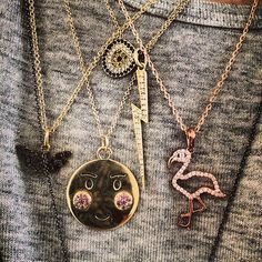 Leandra from Man Repeller layers several gold necklaces all of same length and similar size pendants.