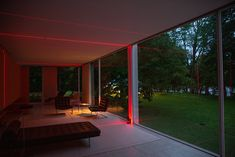 A view from inside Farnsworth House shows the laser beams at play with the surrounding environment. #dwell #contemporaryhomedesignnews #designnews #ludwigmiesvanderrohe
