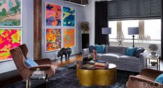 We love that pop art challenges the traditions of fine art by including imagery from popular culture such as advertising and news. It certainly adds a 'pop' of color to this otherwise traditional room. #PopArt  Photo by ELLE DECOR