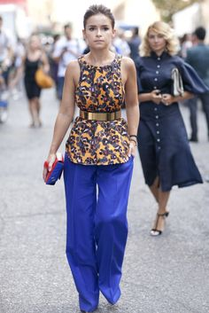 : Miroslava went bold in a printed blouse, wide-leg pants, and a colorblock Chanel in hand.