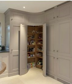 Corner pantry with convex curved doors - grey kitchen cabinets - Bespoke Interiors. Not so much the curved idea but a corner pantry. Kitchen Corner Cupboard, Pantry Cupboard, Kitchen Cabinet Storage, Grey Kitchen Cabinets, Pantry Doors, Kitchen Organization, Pantry Storage, Wall Cabinets, Corner Cabinets
