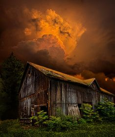 Beautiful old barn under an amazingly sunlit thunder cloud