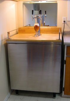"Gill pulls a perfect pint with this hack. ""My husband and I took an old commercial fridge, and refinished it, to become a kegerator. We hit the As-is section of Ikea for the counter top (paid $30), and the rails are actually Enhit curtain rods (not on website), marked down to $4.99. Works perfectly!"" More [&hellip"