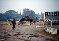 A military tank climbs over a barricade as fighters move through the streets of Senaki during the Georgian Civil War. President Edouard Shevardnadze's troops captured Senaki from the Zviadists in. Type 59, South Ossetia, Modern Warfare, The Republic, Troops, Climbing, Military Tank, Civil Wars, Street