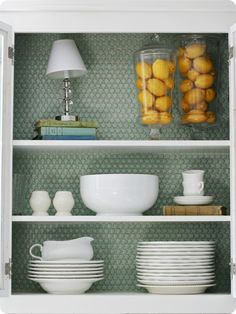 Penny tiled cabinets...love the color and texture it adds to standard cabinets