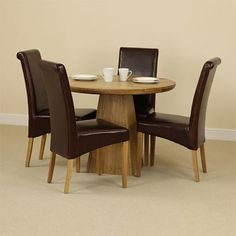 solid oak round dining table with pyramid base 4 brown leather chairs baumhaus aston oak dining set