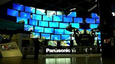 """TV Monument for Panasonic  Seamless Multiscreen Installation    IFA 2012  Consumer Electronics Tradeshow  Berlin, Germany    -  Interactive 3D Realtime Animation  Distributed Rendering on 68 PCs    2 x 34 Smart Viera LED-LCD 55"""" Full HD TV Screens  2 x 34 ASRock Vision 3D Mini PCs  2 x 4 iPad 2"""