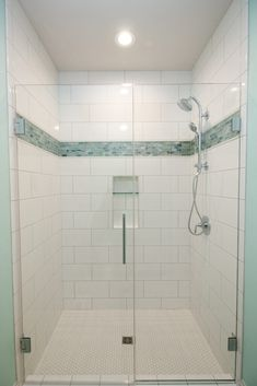 White tiled shower with aqua mosaic accent strip and glass shower door. White Tile Shower, White Tiles, Glass Shower Doors, Remodel, Residential, New Carpet, Shower Doors, Custom Door, Remodeling Projects