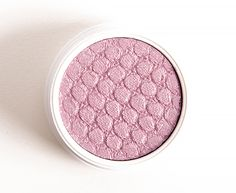 """ColourPop Eye Candy Super Shock Shadow ($5.00 for 0.07 oz.) is described as a """"cool-toned … lavender … with tons of silver and pink glitter."""" It's a light-medium, pink-lilac with subtle, cool undertones and a smattering of silver glitter. It didn't seem all that glittery (which may be good or bad, depending on your preference!). …"""