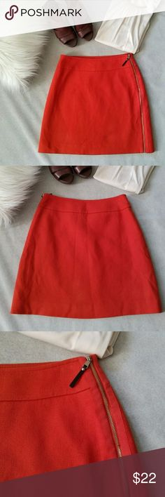 Ann Taylor Heavyweight Mini Skirt Ann Taylor   Petite size 2. Heavyweight fabric mini skirt in a fall orange color. Gold full length zipper. Very good condition. Ann Taylor Skirts Mini