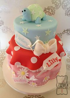 I made this cake for 3 children who were sharing their Christening day. Daisy is the eldest and likes all things pretty and pink, Lilly loves Minnie Mouse and the youngest is baby Finley who, as his mum put it, 'reminds me a bit of a tortoise'! lol. I really enjoyed coming up with this design and making this cake