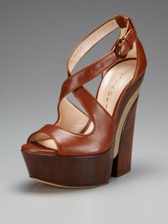 If I really wanted to add 5 inches, I'd commit to these (Criss Cross Wooden Platform Sandal by Casadei on Gilt).