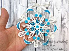 Size 12cm/4.8 inches(approx) without glitter. Decorative handmade Christmas stars in quilling technique. You can hang them up on any holder as decoration; they can make a wonderful gift for special and different occasions. They can be hanged up in the Christmas tree. Cod