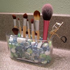 My brush holder on my bathroom counter. I love that it holds them upright so their shape never gets changed over time- round ones will stay round for ex. Very cheap to put together!! I chose beads that matched my bathroom theme.
