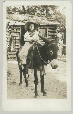Cowboy outfit. Barefoot boy on a donkey.     Courtesy: anyjazz65, Oklahoma (USA).