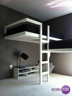 Esse ambiente tem uma decoração minimalista sofisticada. A cama possui um design super diferente e moderno e a cor do quarto tornou o ambiente muito elegante.