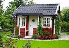 Little red Swedish garden cottage