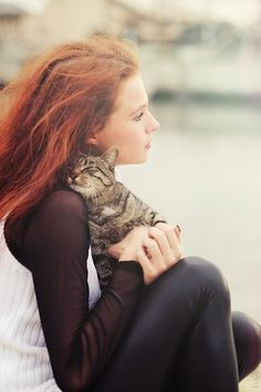 so much happiness here ...a redhead with her feline friend.   I can easily relate to this scenario.