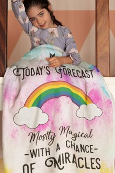 "This comfy and warm ""Today's Foreacast - Mostly Magical With A Chance Of Miracles"" fleece blanket is super soft and perfect for staying warm in winter and curling up by the fire! It's available in multiple sizes. Also be sure to grab a few extra ""Today's Forecast - Mostly Magical"" inspirational blankets because they make the best Christmas gifts and birthday presents! This cute blanket is sure to become a favorite for people who love positive quotes and sayings. Kids absolutely love them! Miracle Blanket, Cuddling On The Couch, Cute Blankets, Inspirational Quotes Pictures, Positive Living, Best Christmas Gifts, Kid Beds, Curling, Birthday Presents"