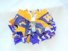 This is not a licensed University of Washington product. It is however, hand crafted from licensed University of Washington ribbon. I am not affiliated with or sponsored by University of Washington. This is a multi-layered handcrafted cheer bow/hair bow. It combines 8 different bows