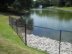 White Fence Company installed this tall black chain link fence around a beautiful fountain pond. Black Chain Link Fence, Fence Around Pool, Fencing Companies, White Fence, Childproofing, Cool House Designs, Curb Appeal, Outdoor Spaces, Pond Ideas