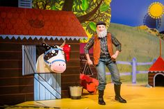 The farmer with his fine prize cow from What The Ladybird Heard Live #dubai #theatre #westend #juliadonaldson