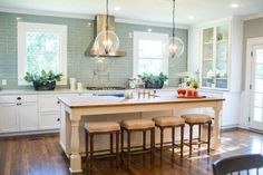 Love the butcher block island and color of stain. Love the chairs to eat at island. Change out tile for white subway.