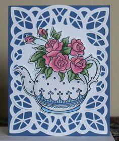 Cut the lace piece on a Silhouette machine.  Fussy cut the teapot and mounted on dimentionals.  Copic colored.