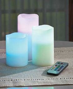 Add candlelight to your home without the danger of fire with this Set of 3 Color-Changing Remote Control Candles. These flameless wax candles are cool to the to