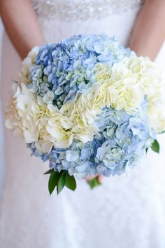"""""""From the beginning, I was obsessed with navy blue and peach accents,"""" Emily says. She tied the bolder color into her bouquet with blue and white hydrangeas. Each flower was picked out from a local Wegmans floral department."""