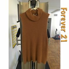 Zippered Turtleneck Tunic Zippered Turtleneck Tunic. Size: Large. Fits boxy, as shown in the modeled photo in photo three. Color: Camel. Brand: Forever 21. It's still in very good condition and is oversized. Includes a zipper in the back. The arm holes are dropped, so be sure to wear proper undergarments. This blouse is 62% cotton and 38% acrylic. Hand wash cold ✨ Forever 21 Tops Blouses