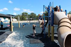 The main Lower School playground has a vibrant and versatile play space for students in Kindergarten-5th grade. It features multiple swings, two slides, low and high monkey bars, a small rock climbing wall, large tube to crawl through, a see-saw, and a sandbox. There are also shaded areas with sun shades and awnings, picnic tables for snacking, and the ground is covered with blue rubber mulch for safety.  Prekindergarten has their own private play area that has padded tiles, a sandbox…