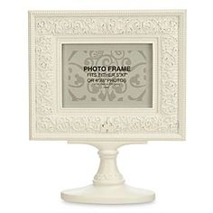 Disney Parks Pedestal Photo Frame | Disney StoreDisney Parks Pedestal Photo Frame - You'll be placed on a pedestal with this uniquely detailed sculptured photo frame adorned in ''hidden Mickey'' filigree and accented by a Fantasyland Castle silhouette. Fits either 5'' x 7'' or 4'' x 6'' photos, displayed horizontally.