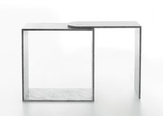 Carrara marble furniture for Marsotto Edizioni presented in Milan