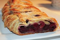 Cherry Strudel: Something kind of magical happens when you combine fruit, flour, sugar, and cinnamon together, wrap it all up in puffed pastry, and pop it in the oven. This strudel is so easy to make with an outcome that's perfect every time. And lucky for us, one of the most popular brands of puff pastry is naturally vegan, which makes this dessert really perfect.