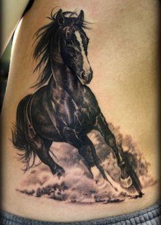 Eric Marcinizyn black horse tattoo. Getting this much detail in a nearly all black subject is amazing!