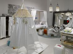 This is just ridiculously styled but still love the concept of a tent within a kid's room.