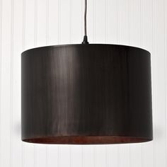 """Metal Drum Shade Pendant Light - 3 Colors Handcrafted metal drum shade pendants bring a mood of rustic refinement. Earthy metal is hand finished in your choice of Antique Pewter, vintage Black or antique Gold. 2x60 watts. 7' cord. (10""""Hx16""""W)"""