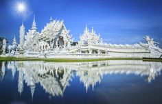 Magnificently grand white church and reflection in the water, Rong Khun temple, Chiang Rai province, northern Thailand #Decor