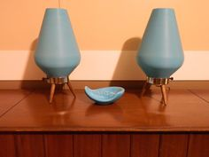 2 Atomic Eames Era Mid Century Modern retro Bee hive lamps with teak legs. $225.00, via Etsy.