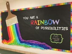 Bulletin board rainbow colors art- plastic tablecloths were used