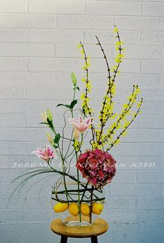 With a touch of lemon: forsythia, hydrangea, oriental lilies, lily grass and lemons.