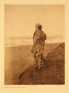 c. 1909 Tolowa Indian woman, southern Oregon coast. She is wearing a basketry hat and beaded clothing. Part of the tribe was removed to the Siletz reservation. Photo by Edward Curtis  (Native American, Oregon, Pacific Ocean, beaded, beadwork)