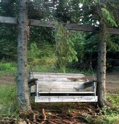 Tree trunk posts & wood swing for two