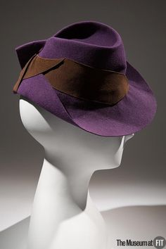 Hat | United States, circa 1936 | Materials: purple felt, brown grosgrain | The Museum at FIT, New York